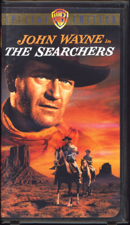 The Searchers VHS cover art. Movie starring John Wayne. With Jeffrey Hunter, Vera Miles, Ward Bond, Natalie Wood. Directed by John Ford. 1956.