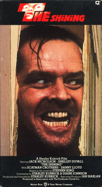 The Shining VHS cover art. Movie starring Jack Nicholson, Shelley Duvall. With Danny Lloyd, Scatman Crothers, Barry Nelson. Directed by Stanley Kubrick. Based on a novel by Stephen King. 1980.