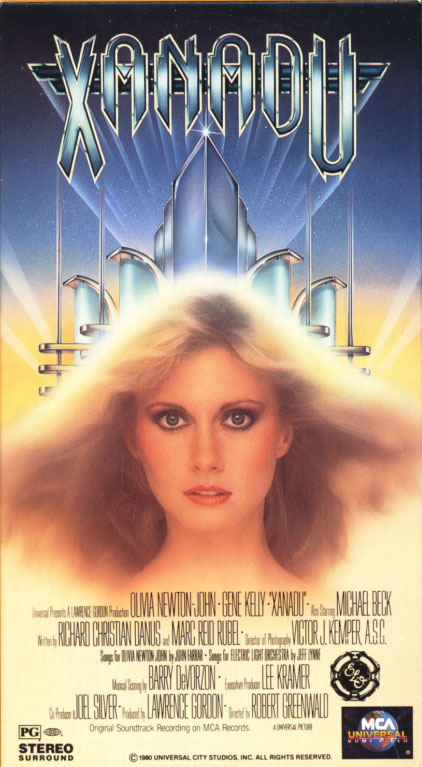 Xanadu VHS cover art. Movie starring Olivia Newton-John, Gene Kelly. With Michael Beck, Teri Beckerman, Sandahl Bergman. Directed by Robert Greenwald. 1980.
