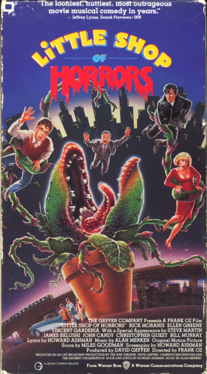 Little Shop of Horrors VHS cover art. Movie starring Rick Moranis, Ellen Greene, Vincent Gardenia, Steve Martin. With Tichina Arnold, Tisha Campbell-Martin, James Belushi, John Candy, Christopher Guest, Bill Murray. Directed by Frank Oz. 1986.