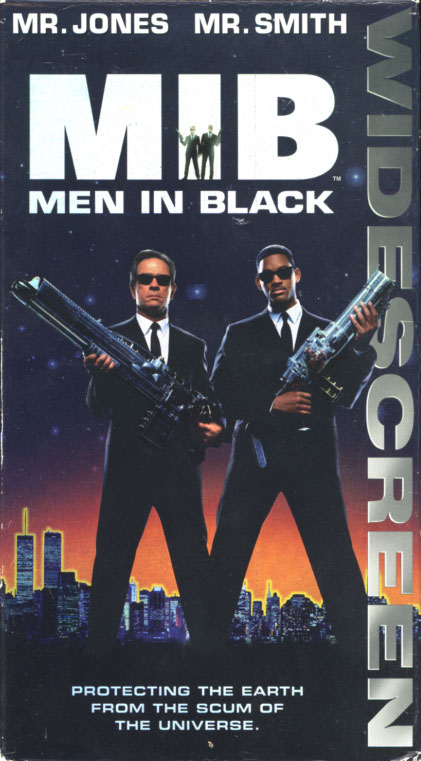 Men in Black VHS cover art. Movie starring Tommy Lee Jones, Will Smith, Linda Fiorentino, Vincent D'Onofrio, Rip Torn, Tony Shalhoub, David Cross. Directed by Barry Sonnenfeld. 1997.