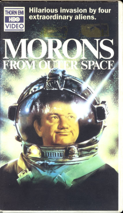 Morons from Outer Space VHS cover art. Movie starring Griff Rhys Jones, Mel Smith, James Sikking, Dinsdale Landen. With Joanne Pearce, Jimmy Nail, Paul Bown. Directed by Mike Hodges. 1985.