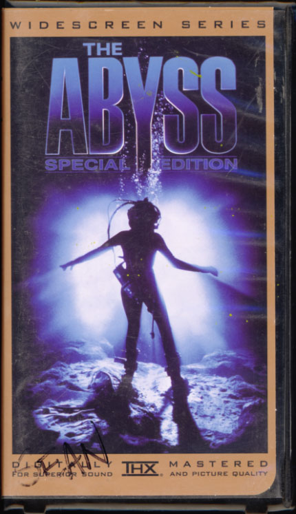 The Abyss VHS cover art. Movie starring Ed Harris, Mary Elizabeth Mastrantonio, Michael Biehn. With Leo Burmester, Todd Graff. Written and directed by James Cameron. 1989.
