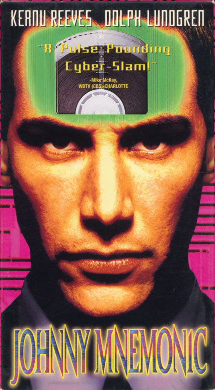 Johnny Mnemonic on VHS. Starring Keanu Reeves, Dina Meyer, Dolph Lundgren, Beat Takeshi Kitano, Ice-T, Henry Rollins, Udo Kier. Written by William Gibson. Directed by Robert Longo. 1995.