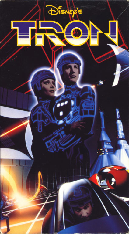 Tron VHS cover art. Movie starring Jeff Bridges, Bruce Boxleitner, Cindy Morgan, David Warner, Barnard Hughes. Directed by Steven Lisberger. 1982.