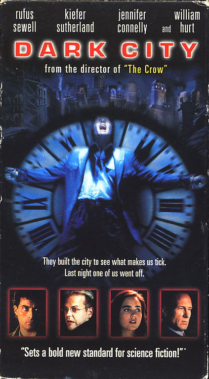 Dark City VHS cover art. Movie starring Rufus Sewell, Kiefer Sutherland, Jennifer Connelly. With William Hurt, Richard O'Brien. Directed by Alex Proyas. 1998.