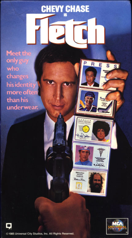 Fletch VHS cover art. Movie starring Chevy Chase, Dana Wheeler-Nicholson, Tim Matheson, Richard Libertini, Joe Don Baker. With M. Emmet Walsh, George Wendt, Geena Davis, Kareem Abdul-Jabbar. Based on the book by Gregory McDonald. Directed by Michael Ritchie. 1985.