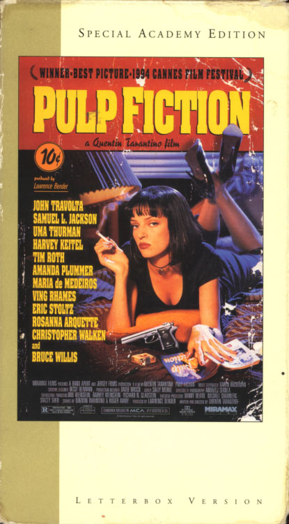 Pulp Fiction VHS cover art. Movie starring John Travolta, Uma Thurman, Samuel L. Jackson. With Bruce Willis, Tim Roth, Amanda Plummer, Eric Stoltz, Rosanna Arquette, Ving Rhames, Peter Greene, Christopher Walken, Harvey Keitel, Maria de Medeiros. Directed by Quentin Tarantino. 1994.
