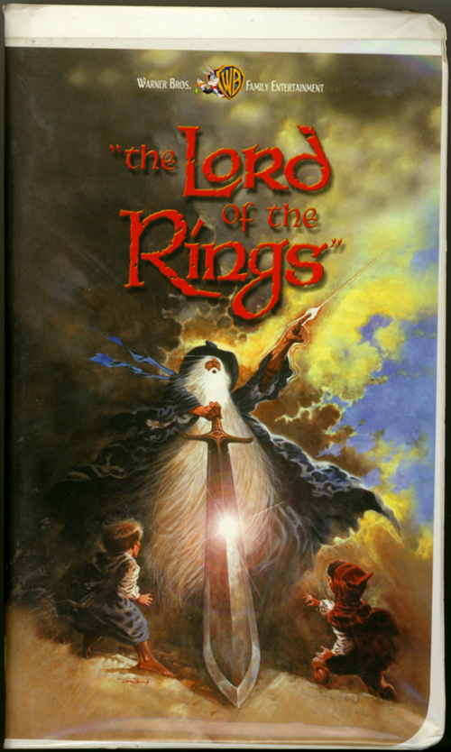 "Lord of the Rings VHS cover art. Animated movie starring Christopher Guard, William Squire, Michael Scholes, John Hurt. Directed by Ralph Bakshi. From the novels ""The Fellowship of the Ring"" and ""The Two Towers"" by J.R.R. Tolkien. 1978."
