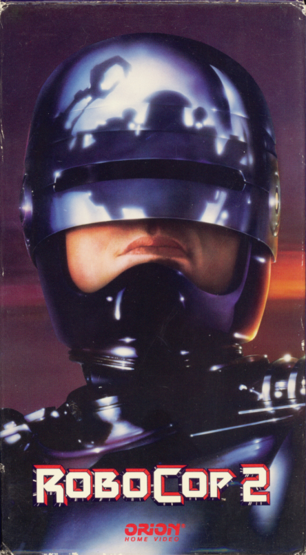 RoboCop 2 VHS cover art. Movie starring Peter Weller, Nancy Allen, Dan O'Herlihy, Belinda Bauer, John Glover, Mario Machado. Written by Frank Miller, Walon Green. Directed by Irvin Kershner. 1990.