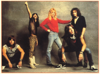 From left to right, Spinal Tap is: Nigel Tufnel,  Derek Smalls,  David St. Hubbins, Mick Shrimpton, Viv Savage.