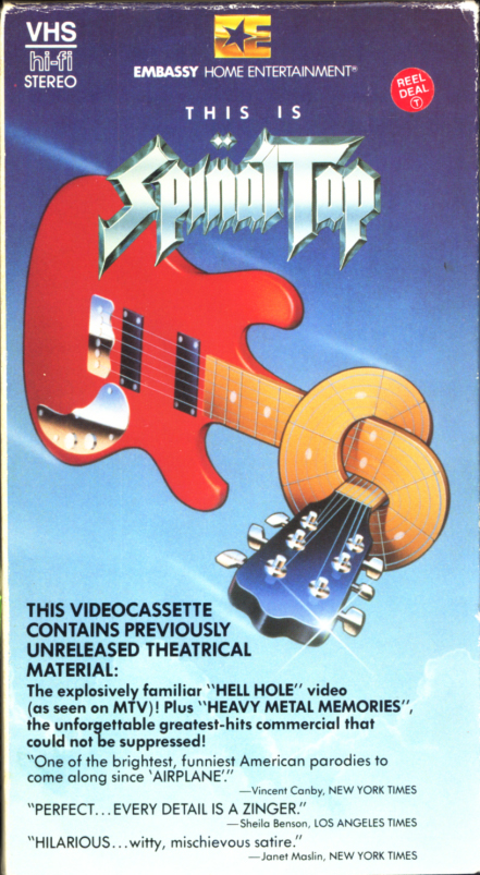 This is Spinal Tap VHS cover art. Movie starring Christopher Guest, Michael McKean, Harry Shearer, Rob Reiner, June Chadwick, Bruno Kirby, Tony Hendra. With Ed Begley Jr., Fran Drescher, Fred Willard, Anjelica Huston, Howard Hesseman, Billy Crystal, Dana Carvey, Paul Shaffer. Directed by Rob Reiner. 1984.