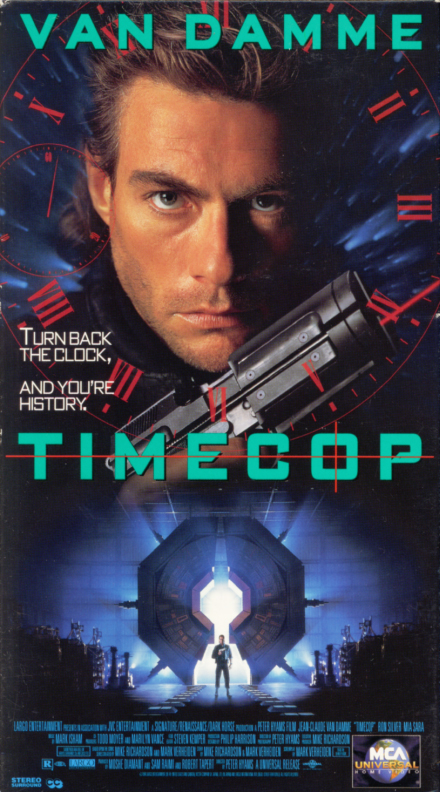 Timecop VHS cover art. Sci-fi movie starring Jean-Claude Van Damme, Mia Sara, Ron Silver, Bruce McGill. Directed by Peter Hyams. 1994.