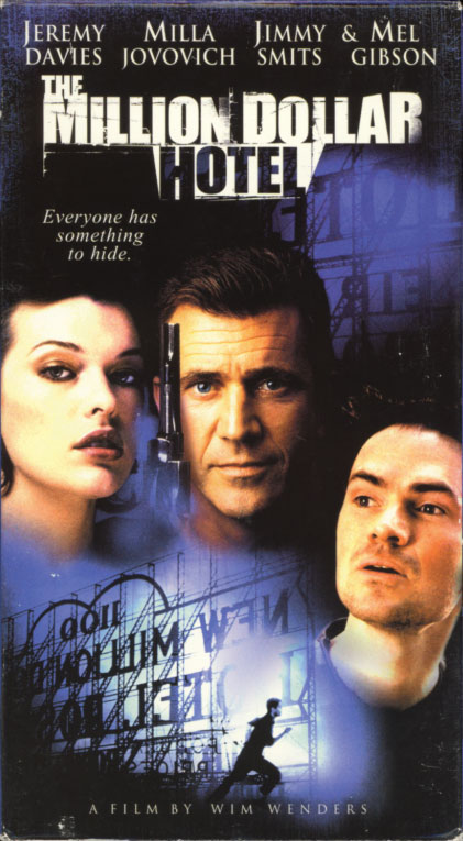 The Million Dollar Hotel VHS box cover art. Movie starring Jeremy Davies, Milla Jovovich, Mel Gibson, Jimmy Smits. With Peter Stormare, Amanda Plummer, Gloria Stuart, Tom Bower, Donal Logue, Bud Cort, Julian Sands, Conrad Roberts, Harris Yulin, Charlayne Woodard. Directed by Wim Wenders. 2000.