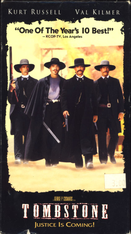 Tombstone VHS box cover art. Action drama western movie starring Kurt Russell, Val Kilmer. With Sam Elliott, Bill Paxton, Powers Boothe, Michael Biehn, Charlton Heston, Jason Priestley, Dana Delany, Billy Zane, Billy Bob Thornton, Jon Tenney, Stephen Lang, Michael Rooker, Joanna Pacula, Robert John Burke. Directed by George P. Cosmatos. 1993.