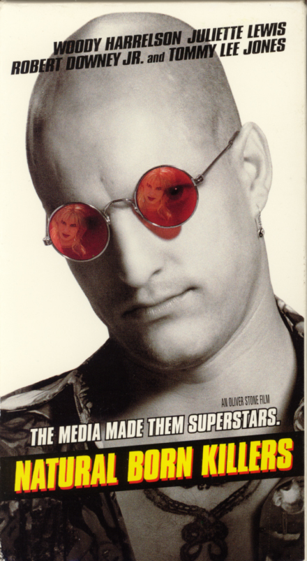 VHS covers: Natural Born Killers. Crime spree movie starring Woody Harrelson and Juliette Lewis. With Robert Downey Jr., Tommy Lee Jones, Tom Sizemore, Rodney Dangerfield. Directed by Oliver Stone. 1994.