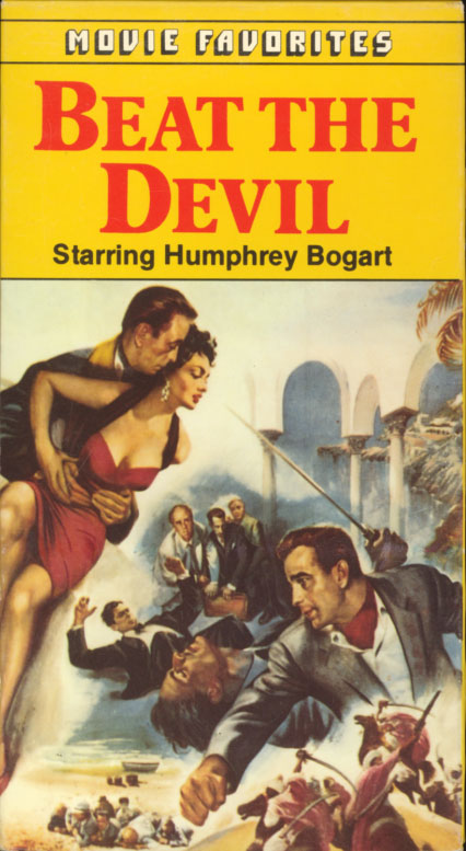 Beat the Devil VHS box cover art. Classic adventure comedy crime movie starring Humphrey Bogart. With Jennifer Jones, Gina Lollobrigida, Peter Lorre, Robert Morley, Marco Tulli, Ivor Barnard, Edward Underdown. Screenplay by Truman Capote. Directed by John Huston. 1953.