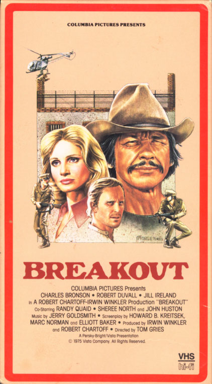 Breakout VHS box cover art. Action adventure drama movie starring Charles Bronson, Robert Duvall, Jill Ireland. With Randy Quaid, Sheree North, John Huston. Directed by Tom Gries. 1975.