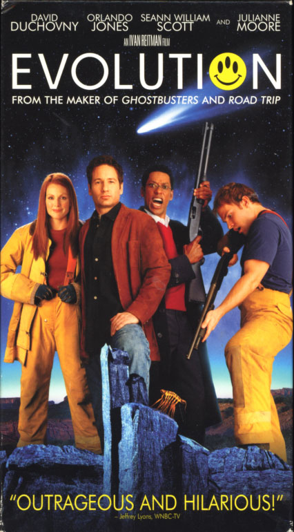 Evolution VHS box cover. Comedy sci-fi movie starring David Duchovny, Orlando Jones, Seann William Scott, Julianne Moore. With Ted Levine, Dan Aykroyd, Sarah Silverman, Richard Moll. Directed by Ivan Reitman. 2001.