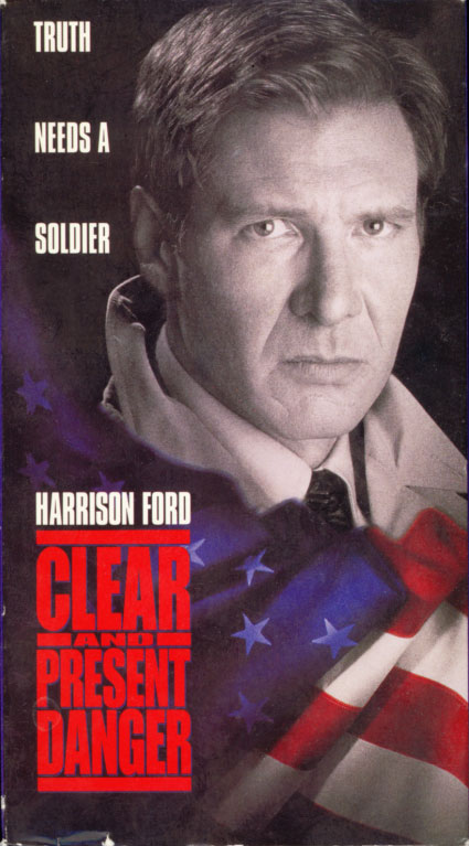 Clear and Present Danger on VHS. Movie starring Harrison Ford. With Willem Dafoe, Anne Archer, Joaquim de Almeida, Henry Czerny, Thora Birch, James Earl Jones. Directed by Phillip Noyce. From a Tom Clancy novel. 1994.