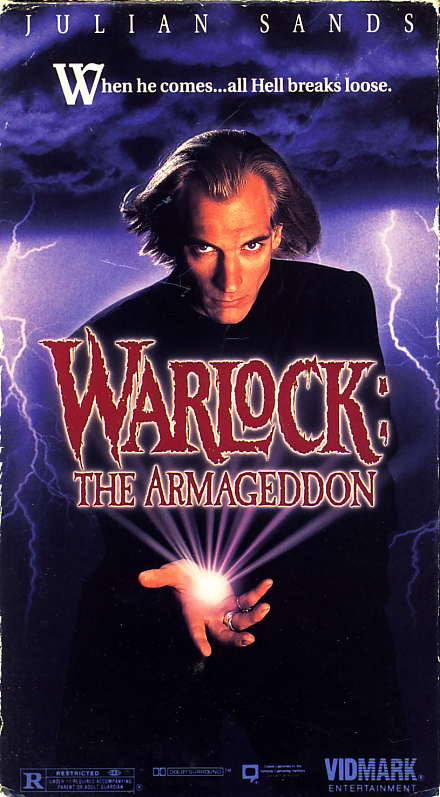 Warlock: The Armageddon on VHS. Horror fantasy movie starring Julian Sands, Chris Young, Paula Marshall. Directed by Anthony Hickox. 1993.